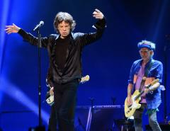 Mick Jagger jokes about government surveillance at concert