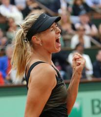 Sharapova continues strong Australian run