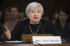 Fed stimulus to continue as Yellen takes chair