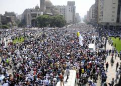 At least three dead as thousands of pro-Morsi supporters march