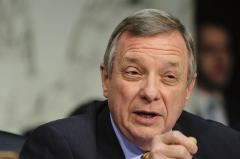 Durbin calls gun background check proposal appealing