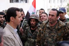 Iranian officials say Assad has won in Syria