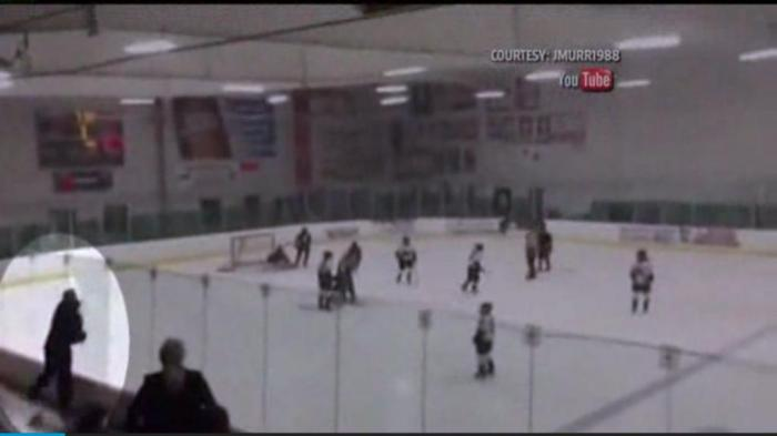 watch mad dad hits through glass at hockey game upicom