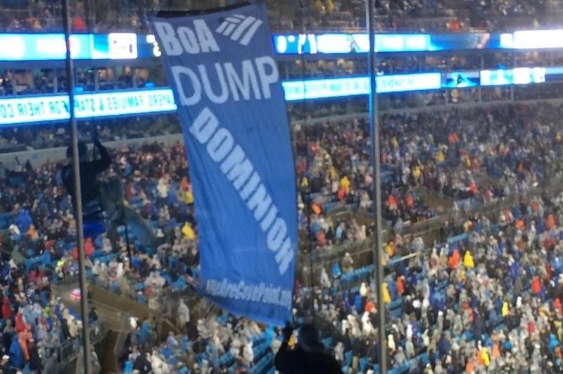 Activists protest lng at televised monday night football for Domon power release