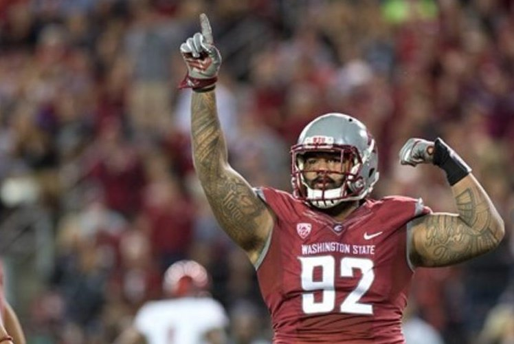 Washington State's Tago arrested in robbery investigation