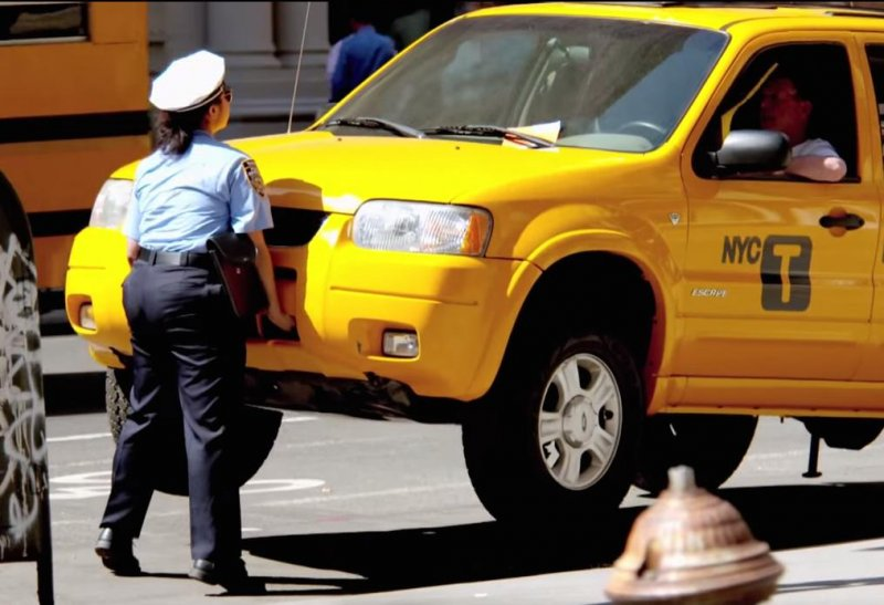 prank video shows meter maid lifting 1 5 ton taxi cab. Black Bedroom Furniture Sets. Home Design Ideas