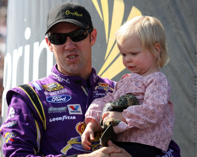Family photo of the driver, married to Katie Martin, famous for NASCAR.