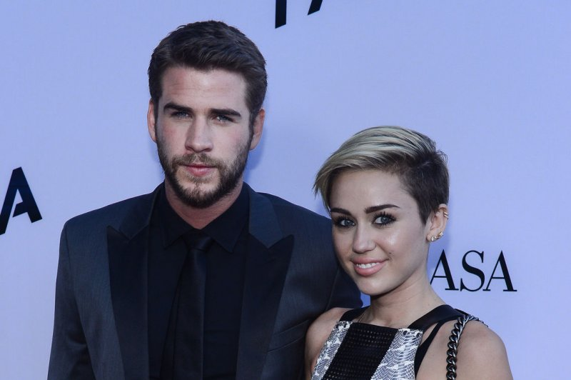 Miley Cyrus and Liam Hemsworth's festive Instagram pics are a Christmas gift
