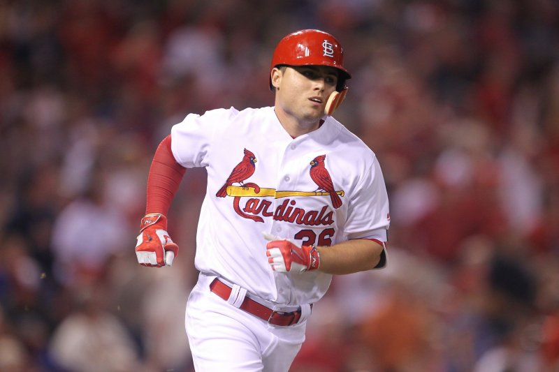 Moss, Diaz hit home runs, Cardinals stall Cubs with 4-2 win