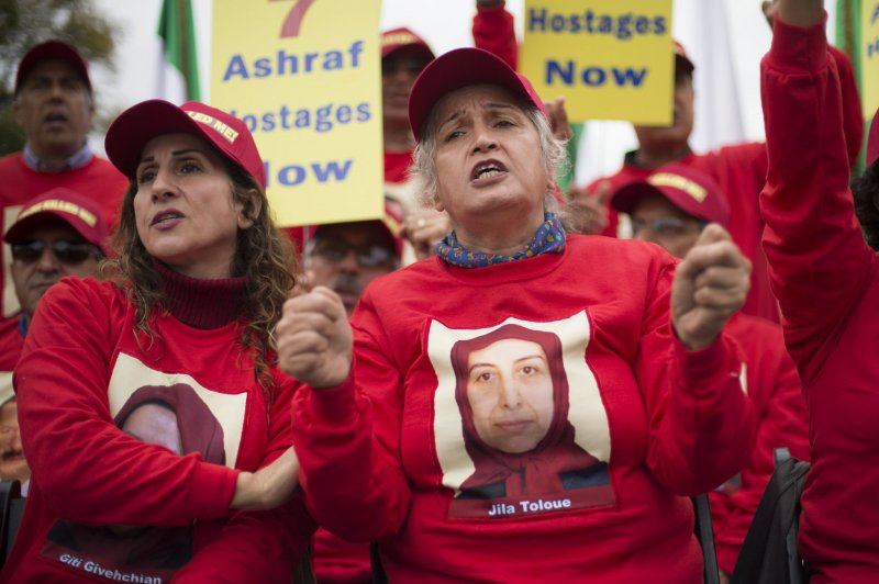 Iranian Maleheh Hosseini (R) participates in a rally at the White House against Iraqi Prime Minister Nuri al-Maliki and his alleged killing of 52 Iranian dissidents at Camp Ashraf in Iraq in 2013. File Photo by Kevin Dietsch/UPI | License Photo