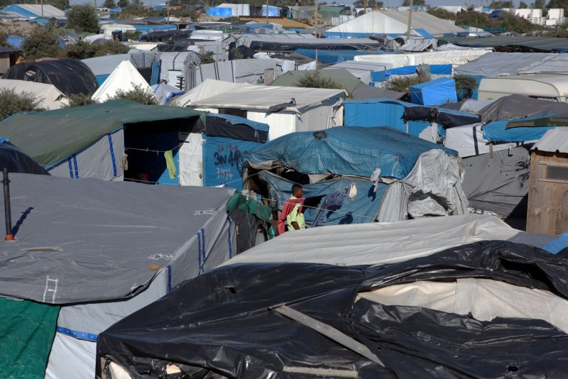 Jungle camp in Calais set afire