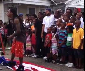 //cdnph.upi.com/sv/em/i/UPI-1951371516333/2013/1/13715168046638/Lil-Wayne-tramples-American-flag-while-filming-music-video.jpg