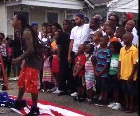 http://cdnph.upi.com/sv/em/i/UPI-1951371516333/2013/1/13715168046638/Lil-Wayne-tramples-American-flag-while-filming-music-video.jpg