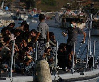 http://cdnph.upi.com/sv/em/i/UPI-1961401728121/2014/1/14017293139620/Smugglers-of-migrants-arrested-in-Italy.jpg
