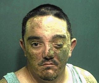 http://cdnph.upi.com/sv/em/i/UPI-2981406637746/2014/1/14066377798619/Messiest-mugshot-ever-Man-ends-up-with-face-full-of-dirt-after-incident-at-Burger-King.jpg