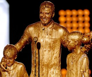 http://cdnph.upi.com/sv/em/i/UPI-3061405710839/2014/1/14057127096287/David-Beckham-sons-get-slimed-at-2014-Kids-Choice-Sports-Awards.jpg