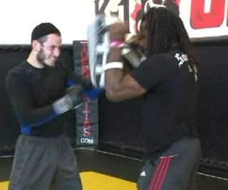 http://cdnph.upi.com/sv/em/i/UPI-3181390504648/2014/1/13905049471469/California-rabbi-wins-first-MMA-fight-by-TKO.jpg