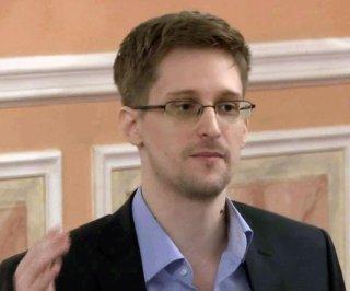 http://cdnph.upi.com/sv/em/i/UPI-3931406906671/2014/1/14069076883905/Snowden-applies-for-renewal-of-Russian-political-asylum.jpg