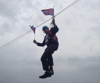 http://cdnph.upi.com/sv/em/i/UPI-49761343927758/2012/1/13439278417727/London-mayor-gets-stuck-on-zip-line.jpg