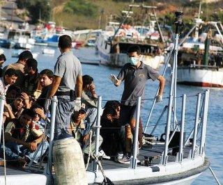 http://cdnph.upi.com/sv/em/i/UPI-5621399049436/2014/1/13990505944498/1170-more-migrants-arrive-in-Sicily.jpg