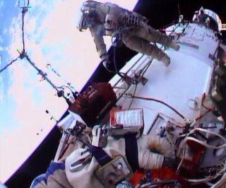 http://cdnph.upi.com/sv/em/i/UPI-6181390840690/2014/1/13908417947307/Russian-astronauts-begin-spacewalk-to-install-Earth-watching-cameras.jpg