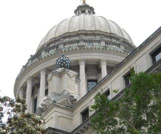 http://cdnph.upi.com/sv/em/i/UPI-6321396637462/2014/1/13964510504187/Mississippi-governor-signs-religious-freedom-bill.jpg