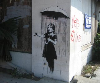 http://cdnph.upi.com/sv/em/i/UPI-6481393453409/2014/1/13934549289276/Banksy-wall-mural-survives-attempted-theft.jpg