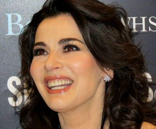 //cdnph.upi.com/sv/em/i/UPI-6761371427549/2013/1/13714276499520/Nigella-Lawson-apparently-choked-by-husband-Charles-Saatchi-in-published-photos.jpg