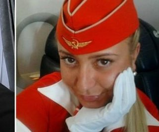 http://cdnph.upi.com/sv/em/i/UPI-6871360178516/2013/1/13601814349369/Flight-attendant-fired-for-finger-Aeroflot-employee-sacked-after-middle-finger-photo-goes-viral.jpg