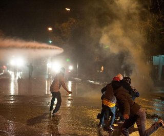http://cdnph.upi.com/sv/em/i/UPI-7161396371712/2014/1/13963739374434/Riot-police-and-water-cannons-disperse-Ankara-election-protesters.jpg