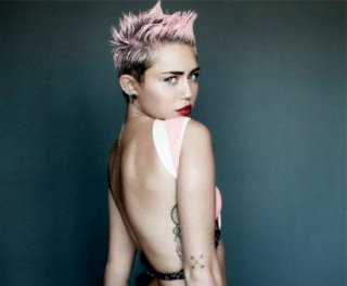 //cdnph.upi.com/sv/em/i/UPI-7801367445430/2013/1/13674464788203/Miley-Cyrus-shows-some-skin-in-racy-V-cover-shoot.jpg