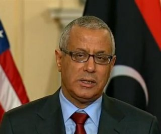 http://cdnph.upi.com/sv/em/i/UPI-7921394639409/2014/1/13946404721970/Ousted-Libyan-PM-flees-to-Europe-despite-travel-ban.jpg