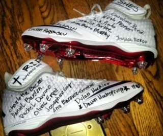 http://cdnph.upi.com/sv/em/i/UPI-8041355845149/2012/1/13558467329533/Football-player-wrote-names-of-Newtown-Conn-victims-on-his-cleats-for-game-against-Jets-PHOTO.jpg