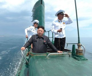 http://cdnph.upi.com/sv/em/i/UPI-8131402942620/2014/1/14029443805726/Kim-Jong-Un-inspects-North-Korean-submarine-calls-for-better-combat-readiness.jpg