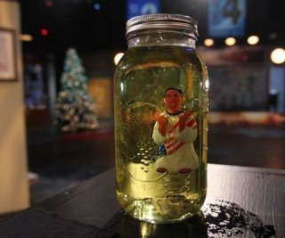 //cdnph.upi.com/sv/em/i/UPI-8361354116904/2012/1/13541235533210/Glenn-Beck-tries-art-dips-Obama-toy-in-jar-of-fake-urine-VIDEO.jpg