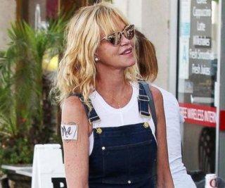 http://cdnph.upi.com/sv/em/i/UPI-8611406732185/2014/1/14067343188288/Melanie-Griffith-hides-Antonio-Banderas-tattoo-with-her-name.jpg