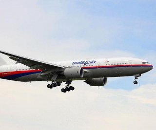 http://cdnph.upi.com/sv/em/i/UPI-8911405696156/2014/1/14056971006217/Investigators-reach-Malaysia-Airlines-crash-site-in-Ukraine.jpg