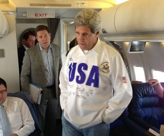 http://cdnph.upi.com/sv/em/i/UPI-9111391532537/2014/1/13915339009372/Secretary-Kerry-to-drop-hockey-puck-at-Olympic-send-off-in-Washington-DC.jpg