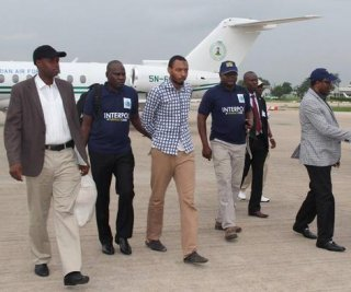 http://cdnph.upi.com/sv/em/i/UPI-9131405523830/2014/1/14055258039313/Interpol-turns-over-extradited-bombing-suspect-to-Nigeria.jpg