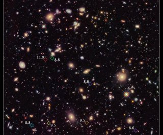 //cdnph.upi.com/sv/em/i/UPI-93901355435385/2012/1/13554393276136/Hubble-spots-some-of-the-earliest-galaxies.jpg