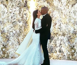 http://cdnph.upi.com/sv/em/i/UPI-9491407250415/2014/1/14032014931218/Kim-Kardashian-unveils-who-got-too-drunk-at-her-wedding.jpg