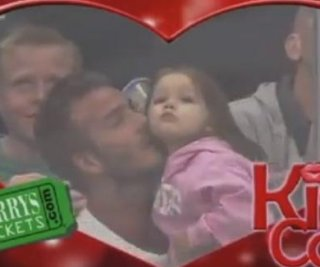 http://cdnph.upi.com/sv/em/i/UPI-9981369849591/2013/1/13698503349338/VIDEO-David-Beckham-caught-on-kiss-cam-with-baby-Harper.jpg