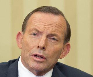 http://cdnph.upi.com/sv/em/upi/UPI-1321405604676/2014/1/557bb0a70855d36741695bd73e2d9154/Australia-scraps-carbon-tax-scheme.jpg
