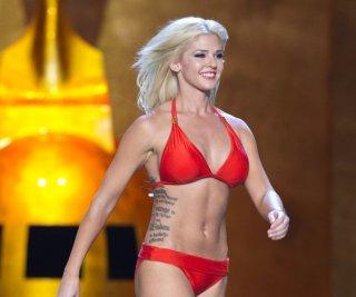 http://cdnph.upi.com/sv/em/upi/UPI-16951379009908/2013/1/284cdbcafff62e4d023ff13a5e4b3f12/Miss-America-contestant-first-to-let-her-tattoos-show.jpg