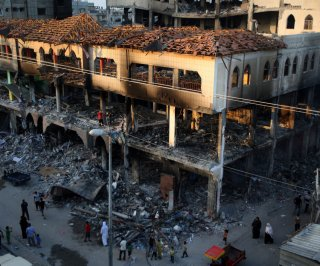 http://cdnph.upi.com/sv/em/upi/UPI-3961409059931/2014/1/a9c520ba7236fbfa2d434cba2d50e7d8/Israeli-airstrikes-topple-Gaza-high-rises.jpg