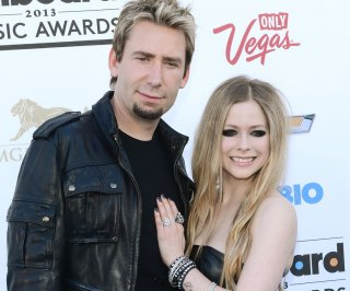 http://cdnph.upi.com/sv/em/upi/UPI-5201388018422/2013/1/5147f167ac22f1b9dafb57f8967c02f5/Avril-Lavigne-tones-down-her-look-in-Allure-make-under.jpg