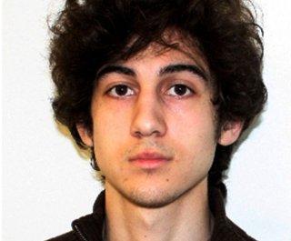 http://cdnph.upi.com/sv/em/upi/UPI-65251366351810/2013/1/6657dd041b9a780e90728983d2a8a87a/Boston-Marathon-manhunt-Suspect-in-custody.jpg