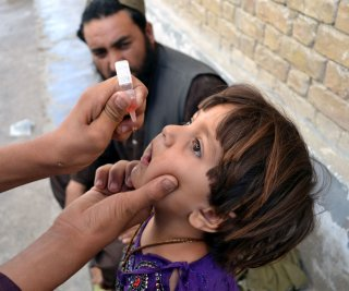 //cdnph.upi.com/sv/em/upi/UPI-70141388235168/2013/1/49f113747a1eb1a98f4dbf84479922f0/Polio-worker-killed-two-wounded-in-attack-on-Pakistan-hospital.jpg