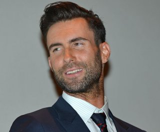 http://cdnph.upi.com/sv/em/upi/UPI-7481384473269/2013/1/27b6d15d4c10130bfe2ebbdf8b9a905b/Adam-Levine-cheers-on-fiancee-Behati-Prinsloo-at-Victorias-Secret-Fashion-Show.jpg