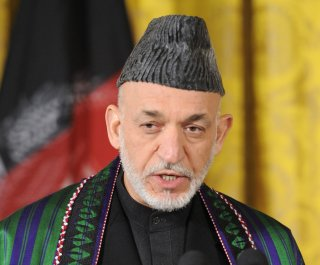http://cdnph.upi.com/sv/em/upi/UPI-78241374073393/2013/1/25cb8458ff2119ab2a26be987d20ede7/Afghan-President-Hamid-Karzai-approves-election-law.jpg